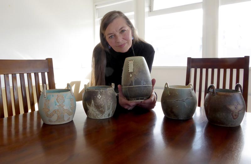 Hedy Ankers with some pots she made. Photo credit Penny Griffith